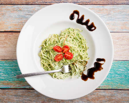 tasty spinach with spaghetti pasta on white plate Banco de Imagens