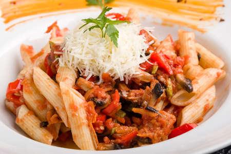tasty vegetarian penne pasta in white plate
