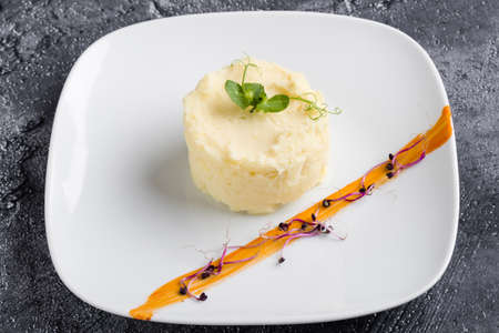 fresh mashed potato portion on white plate