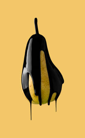abstract image of black paint dripping on fruit Stock Photo