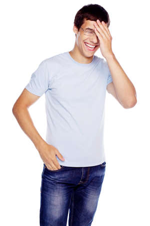 man arm: Laughing young man in glasses and blue shirt with hand on his face isolated on white background