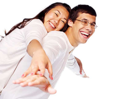 couple having fun: Laughing young interracial couple in love having fun posing as flying isolated on white background Stock Photo
