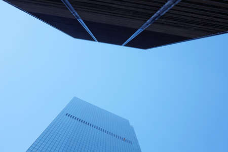 Low angle view of smoggy modern business centre building in downtown