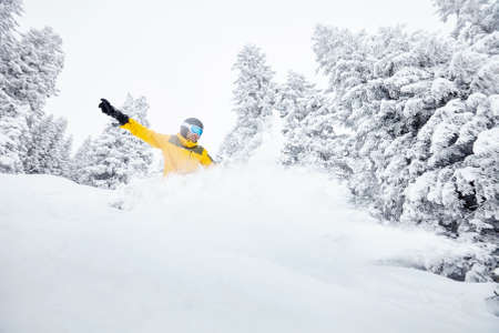 deep powder snow: Male snowboarder having fun in deep backcountry powder snow during winter blizzard in Alps - extreme sports concept Stock Photo