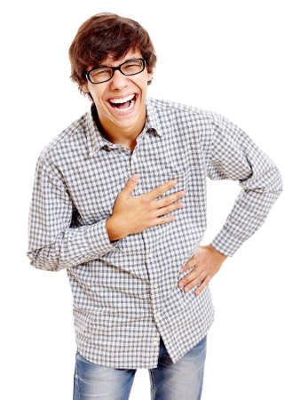 Young hispanic man wearing checkered shirt, blue jeans and black glasses standing with hand on his chest and laughing out loud isolated on white background - humor concept Stock Photo