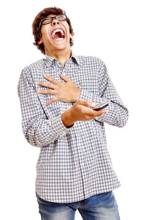 laughing out loud: Young hispanic man wearing blue checkered shirt and black glasses holding mobile phone in his hand and laughing out loud isolated on white background - humor and communication concept