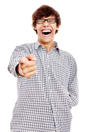 laughing face: Young hispanic man wearing blue checkered shirt and black glasses pointing at camera with his index finger and laughing out loud isolated on white background - humor concept