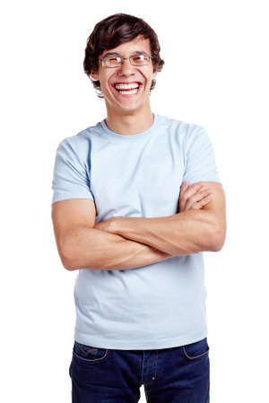 Portrait of young hispanic man wearing glasses, blue t-shirt and jeans standing with crossed arms and laughing isolated on white background - laughter concept