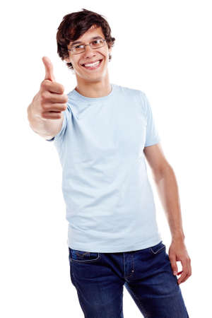 good looking teenage guy: Young hispanic man wearing glasses, blue t-shirt and jeans showing thumb up hand gesture and smiling isolated on white background - success concept Stock Photo