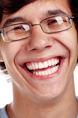 laughing face: Face close up of young hispanic man wearing glasses and smiling perfect healthy toothy smile over white background - dentistry or ophthalmology concept