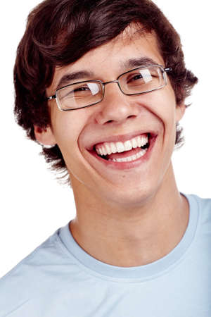 laughing face: Face close up of young hispanic man wearing glasses and blue t-shirt smiling perfect healthy toothy smile over white background - dentistry or ophthalmology concept