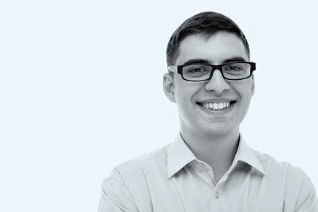 open collar: Blue toned black and white portrait of young smiling man wearing glasses and formal shirt with open collar - business concept
