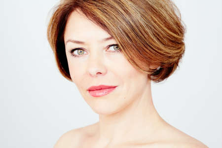 naked lady: Close up portrait of beautiful middle aged woman with short brown hair, red lips and fresh makeup over white background  - beauty concept