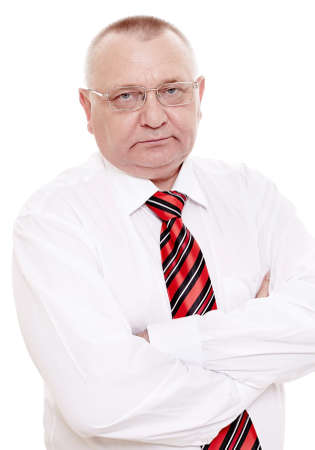 old man standing: Serious middle aged businessman wearing glasses, red and black striped tie with white shirt standing with crossed arms isolated on white background - experienced human resources concept