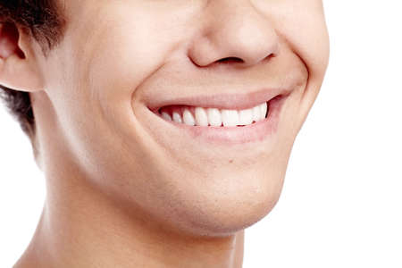 Close up of young man smiling with perfect healthy white teeth isolated on white background - dental care concept Stock Photo