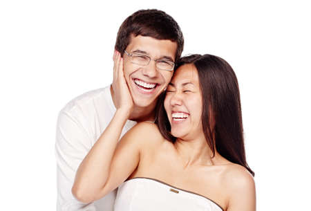 laughing out loud: Portrait of young lovely interracial couple, hispanic man and asian girl, hugging and laughing out loud isolated on white background - laughter concept