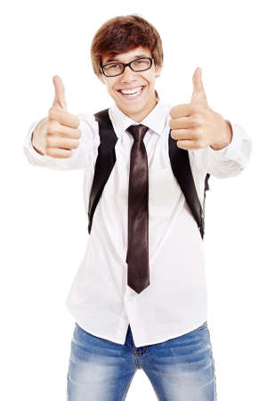 Young man with backpack wearing glasses, blue jeans, white shirt and black tie showing thumbs up hand gesture with both hands and smiling perfect healthy toothy smile isolated on white background
