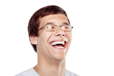 Face close up of young man wearing glasses and blue t-shirt laughing isolated on white background - laughter is best medicine concept