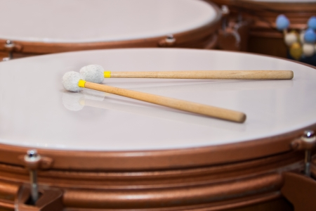 Drum sticks lying on the timpani Stok Fotoğraf