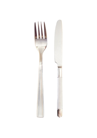 Knife and fork parallel on a white background photo