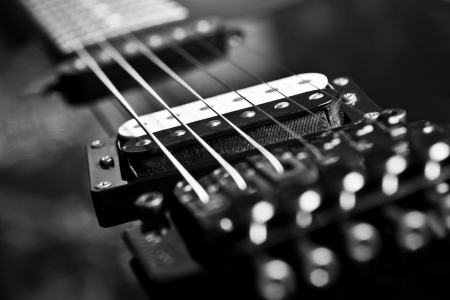 Fragment string electric guitar in black and white