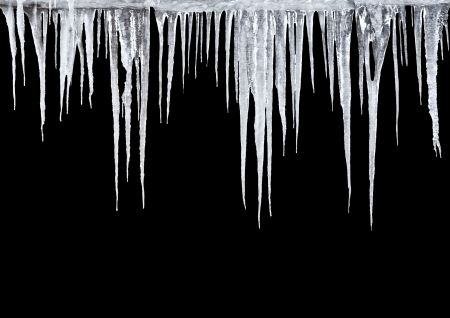 sunny cold days: Icicles on a black background Stock Photo