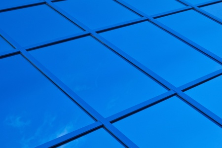 diagonals: A fragment of blue glass building in the background