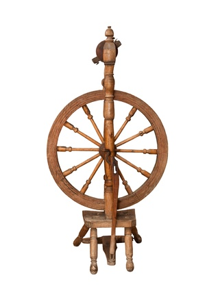 Antique spinning wheel isolated on white photo