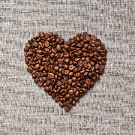 Coffee beans in the shape of heart on linen fabric Stock Photo - 23077054