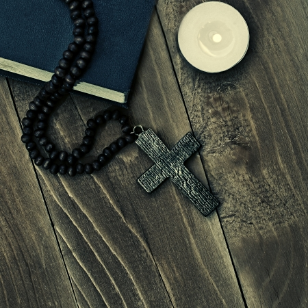 Iron cross with a book on a wooden surface  Stock Photo