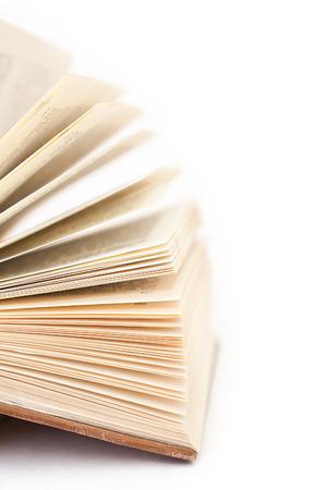 Detail of open book on white Reklamní fotografie - 24986723