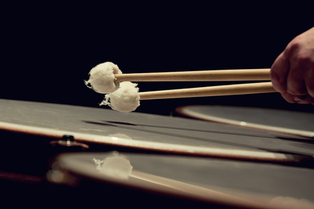 musical instrument parts: Drum sticks hitting the timpani closeup
