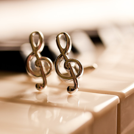 Ornaments in the form of a treble clef on piano keyboard Stok Fotoğraf