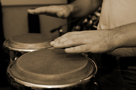Hands of man playing the bongos Stock Photo