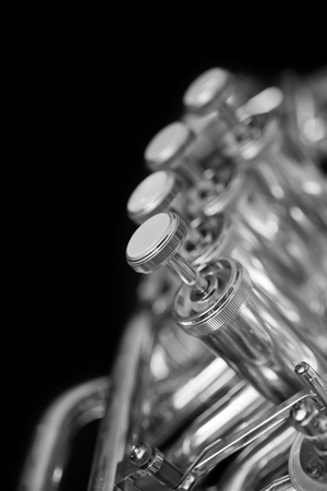 tuba: Fragment of a bass tuba valves closeup in black and white Stock Photo