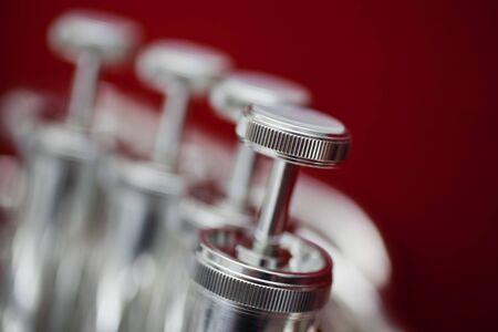 brassy: Fragment of a bass tuba valves closeup Stock Photo