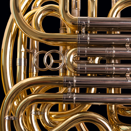 Fragment french horn closeup on a black background Stock Photo