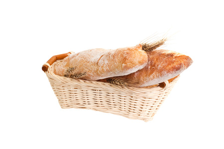 Bread in breadbasket isolated on white