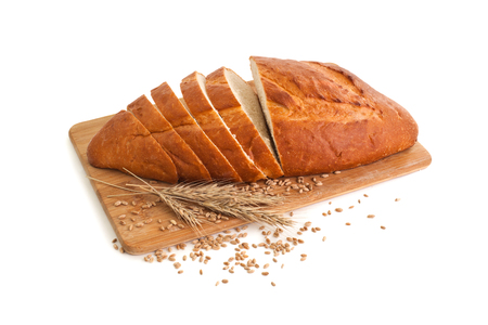 Sliced ??loaf of bread on a cutting board on a white background