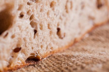 Piece of bread on canvas fabric closeup Reklamní fotografie