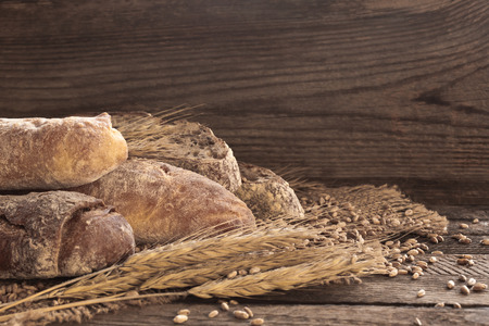Different bread on a wooden background in dark tones