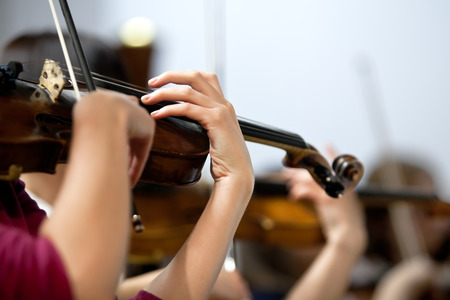 Hands of a girl playing the violin in the orchestra Reklamní fotografie