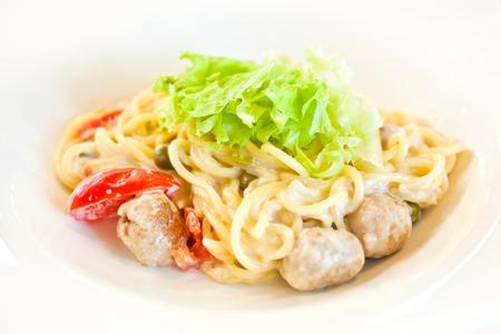 Pasta with meatballs closeup