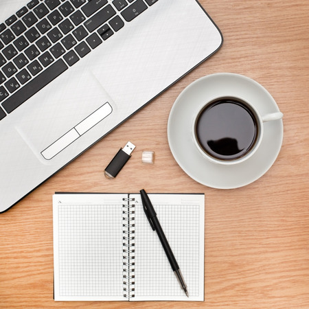 Office accessories with a laptop and a cup of coffee on the table Reklamní fotografie