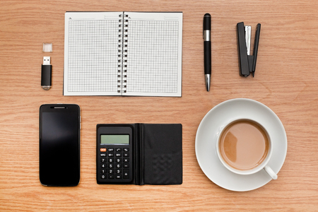 Office accessories with a cup of coffee on the table