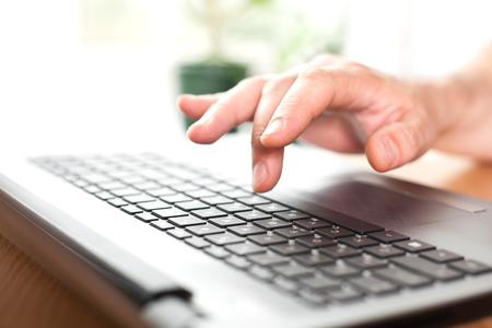 Hand on the laptop keyboard closeup Reklamní fotografie
