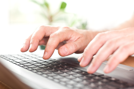 Hands on the laptop keyboard closeup