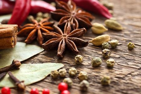Various spices on a wooden surface closeup Reklamní fotografie