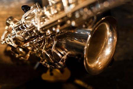 Fragment of a saxophone closeup in dark colors