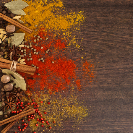 Different spices on a wooden surface Reklamní fotografie - 93648216
